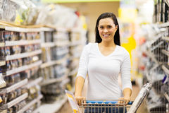 Woman trolley supermarket. Beautiful young woman pushing trolley in supermarket Stock Photography