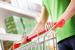 Woman with trolley at supermarket Royalty Free Stock Photo