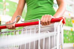 Woman with trolley at supermarket Royalty Free Stock Photos