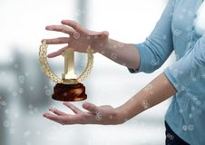 Woman with a trophy on hands. Digital composite of Woman with a trophy on hands Stock Photography