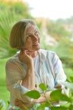Woman at tropic resort Stock Images