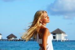 Woman on tropical beach Royalty Free Stock Photo