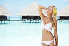 Woman on tropical beach Stock Photo