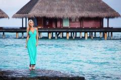 Woman on tropical beach Stock Image
