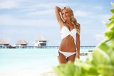 Woman on tropical beach Stock Images