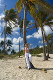 Woman on tropical beach Royalty Free Stock Image