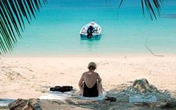 Woman on tropical beach Stock Photos