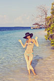 Woman on a tropical beach Stock Image