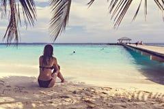 Woman on a tropical beach Stock Photography