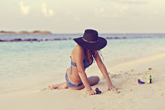 Woman on a tropical beach Stock Images