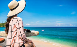 Woman at tropical beach with coffee cup having breakfast Royalty Free Stock Image