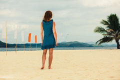 Woman on tropical beach with flags Stock Photo