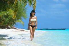 Woman at the tropical beach. Happy woman in bikini on tropical beach Stock Photo