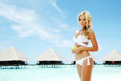 Woman on tropical beach Royalty Free Stock Photos