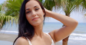 Woman on Tropical Beach Looking into the Distance. Head and Shoulders Portrait of Attractive Smiling Woman with Long Dark Hair Looking into the Distance with stock video footage