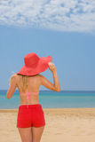 Woman on tropical beach in red shorts Stock Photography