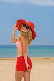 Woman on tropical beach in red shorts Stock Images