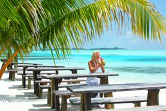 Woman in a tropical cafe Stock Photos