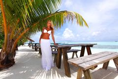 Woman in a tropical cafe Royalty Free Stock Images
