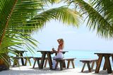 Woman in a tropical cafe Stock Image