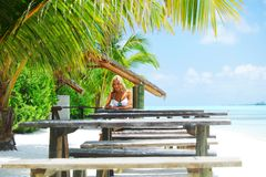Woman in tropical cafe Royalty Free Stock Photo