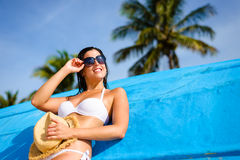 Woman on tropical caribbean vacation relaxing. Young woman relaxing and enjoying at beach during tropical caribbean vacation travel. Beautiful girl in white Royalty Free Stock Images