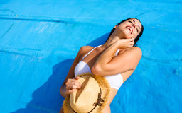 Woman on tropical caribbean vacation relaxing Stock Photo