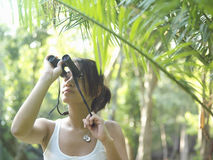 Woman In Tropical Forest Looking Through Binoculars Royalty Free Stock Photos