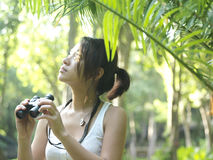 Woman In Tropical Forest Looking With Binoculars Royalty Free Stock Photography