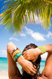 Woman on tropical holiday. A woman on holiday looking over a tropical beach Stock Photo