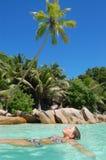 Woman in tropical ocean Stock Images