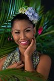 Woman at tropical resort Stock Photos