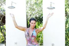 Woman in tropical shower Royalty Free Stock Images