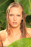 Woman in tropical shower palms around Stock Photos