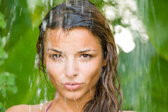 Woman in tropical shower Stock Images