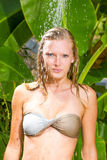 Woman in tropical shower Royalty Free Stock Image