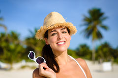 Woman on tropical summer caribbean vacation smiling Royalty Free Stock Images