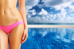 Woman at tropical swimming pool Stock Images