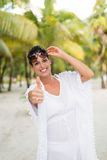 Woman on tropical vacation travel Stock Photography