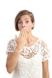 Woman in trouble gesturing oops with a hand on mouth Royalty Free Stock Image