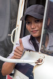 Woman truck driver in the car. Gesturing thumb up Royalty Free Stock Photo