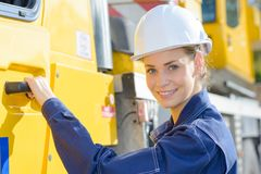 Woman truck driver getting in cabin Stock Photos