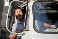 Woman truck driver looking out the window. Asian woman truck driver looking out the window Royalty Free Stock Images
