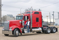 Woman truck driver on the step. A pretty woman prepares to pre-trip inspect her truck Stock Images