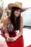 Woman on truck hood Stock Photo