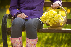 Woman with trug of picked daffodils Royalty Free Stock Photos