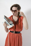 woman try to attempt how hot iron Stock Photography
