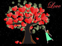 Woman try to catch the heart on tree of love Royalty Free Stock Images