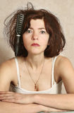 Woman  try to comb hairs Royalty Free Stock Images