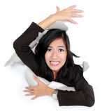 Woman try to get out through a hole Royalty Free Stock Image
